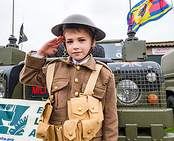 Pictured: Scotland's National Airshow, East Fortune, East Lothian, Scotland, United Kingdom, 27 July 2019 . A packed programme of aircraft old and new planned to take to the skies for the aerial display was marred by poor weather at airfields around the country which meant that many of the promised flights were unable to perform. Harrison, aged 8 years, in World War I soldier's uniform.<br /> Sally Anderson | EdinburghElitemedia.co.uk