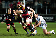 Dragons' Aaron Wainwright under pressure from Ospreys' Bradley Davies<br /> <br /> Photographer Simon King/Replay Images<br /> <br /> Guinness Pro14 Round 12 - Dragons v Cardiff Blues - Sunday 31st December 2017 - Rodney Parade - Newport<br /> <br /> World Copyright © 2017 Replay Images. All rights reserved. info@replayimages.co.uk - http://replayimages.co.uk