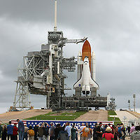 Media photographers line up to take photos of the shuttle Atlantis as it sits on the pad after the rotating service structure is peeled away at the Kennedy Space Center Thursday, July 7, 2011, in Cape Canaveral, Fla. (AP Photo/Alex Menendez)