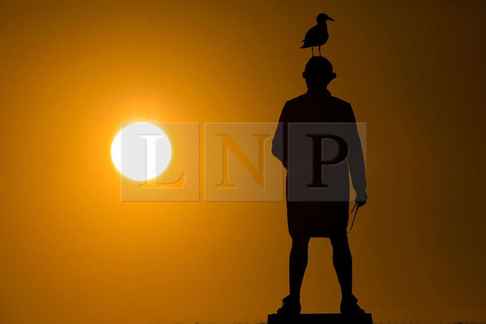 """© Licensed to London News Pictures. 11/06/2020. Whitby UK. File picture taken 21/03/2017 of the Captain Cook statue in Whitby on the Yorkshire coast. The website Topple the Racists has drawn up a hit-list of monuments and statues across the UK that should be taken down if they """"celebrate slavery and racism"""". Among the 60-strong list is the Captain Cook statue in Great Ayton and Whitby residents now fear a statue dedicated to him in Whitby could become a target as well. Photo credit: Andrew McCaren/LNP"""