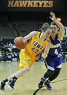 December 20, 2011: Iowa Hawkeyes guard Samantha Logic (22) drives around Drake Bulldogs guard Kyndal Clark (4) during the NCAA women's basketball game between the Drake Bulldogs and the Iowa Hawkeyes at Carver-Hawkeye Arena in Iowa City, Iowa on Tuesday, December 20, 2011. Iowa defeated Drake 71-46.