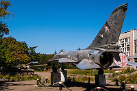 Russia, Sakhalin, Yuzhno-Sakhalinsk. An exhibition of old-style Soviet era military vehicles and planes. An old MIG fighter.
