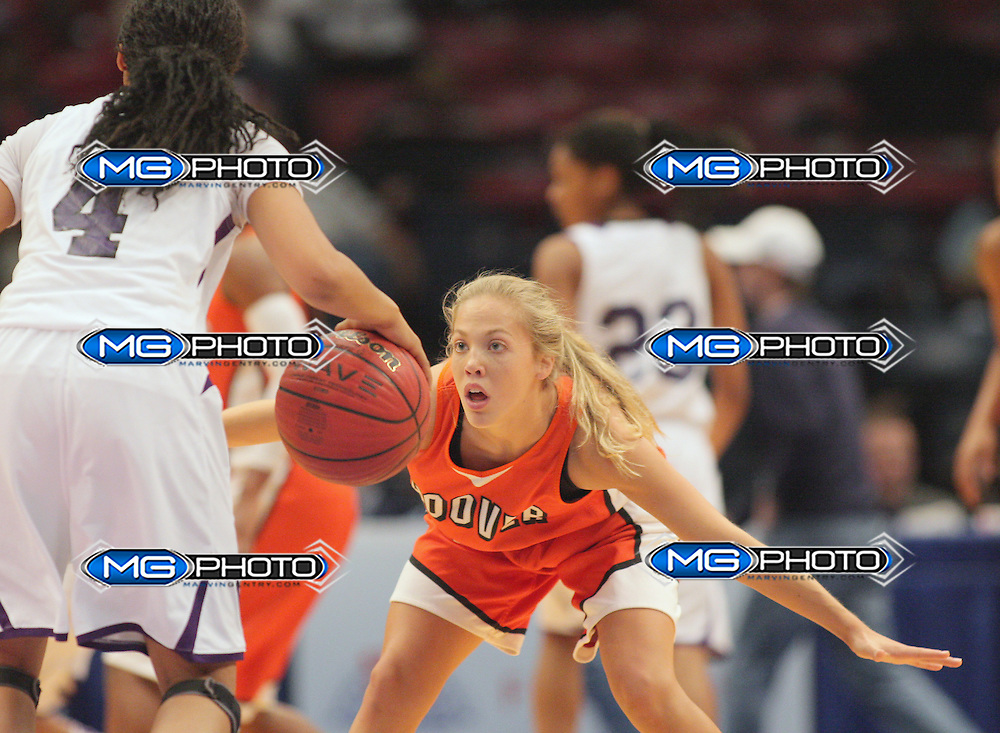 March 2, 2013; Birmingham, AL, USA;  Hoover's Sarah Mitchell (14) plays defense against Blount's Whytney Singleton (4) at the Alabama High School State Basketball Championships at the Birmingham Jefferson Civic Center. Mandatory Credit: Marvin Gentry