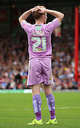 Stephen Quinn (Reading midfielder) with his head in his hands after Reading spurned another glorious opportunity to put the game to bed during the Sky Bet Championship match between Brentford and Reading at Griffin Park, London, England on 29 August 2015. Photo by Matthew Redman.