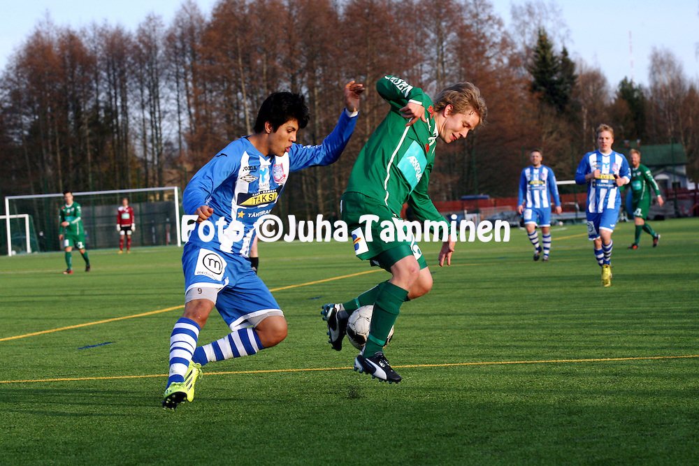 16.4.2014, Pullerin tekonurmi, H&auml;meenlinna.<br /> Suomen Cup 2014, 6. kierros.<br /> FC H&auml;meenlinna - IFK Mariehamn.<br /> Robin Sid (IFK Mhamn) v Omid Musawi (FC Hml).