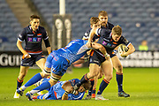 James Johnstone (#13) of Edinburgh Rugby is tackled by James Benjamin (#8) and Matthew Screech (#5) of Dragons Rugby during the Guinness Pro 14 2018_19 match between Edinburgh Rugby and Dragons Rugby at BT Murrayfield Stadium, Edinburgh, Scotland on 15 February 2019.