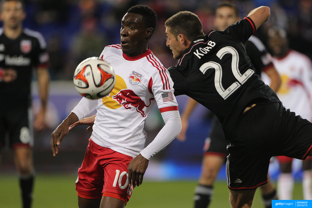 Lloyd Sam, (left), New York Red Bulls, is challenged by Chris Korb, DC United,  during the New York Red Bulls V DC United, MLS Cup Playoffs, Eastern Conference Semifinals first leg at Red Bull Arena, Harrison, New Jersey. USA. 2nd November 2014. Photo Tim Clayton