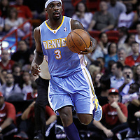 19 March 2011: Denver Nuggets point guard Ty Lawson (3) brings the ball upcourt during the Miami Heat 103-98 victory over the Denver Nuggets at the AmericanAirlines Arena, Miami, Florida, USA.
