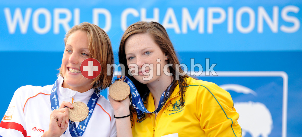Third placed Cate CAMPBELL (R) of Australia and Marleen VELDHUIS poses with her bronze medal after competing in the women's 50m freestyle final at the 13th FINA World Championships at the Foro Italico complex in Rome, Italy, Sunday, Aug. 2, 2009. (Photo by Patrick B. Kraemer / MAGICPBK)