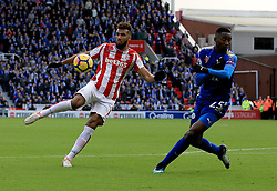 Eric Maxim Choupo-Moting of Stoke City hits a wild shot as Wilfred Ndidi of Leicester City tries to block - Mandatory by-line: Paul Roberts/JMP - 04/11/2017 - FOOTBALL - Bet365 Stadium - Stoke-on-Trent, England - Stoke City v Leicester City - Premier League