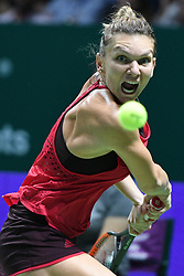 Oct. 23, 2017 - Singapore, Singapore - SIMONA HALEP of Romania hits a return during the group match against Caroline Garcia of France at WTA Finals tennis tournament in Singapore. Halep won 2:0. (Credit Image: © Then Chih Wey/Xinhua via ZUMA Wire)