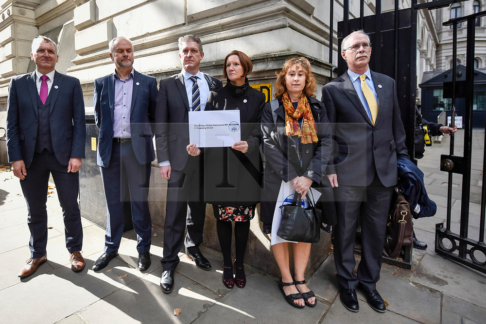 © Licensed to London News Pictures. 28/09/2018. LONDON, UK.  A group of six head teachers stand outside the entrance to Downing Street with a petition to be delivered to Number 11 Downing Street after hundreds of head teachers gathered at a rally in Parliament Square to demand extra funding for schools.  With a reported reduction in per student funding in real terms since 2010, members of the National Union of Head Teachers and the Association of School and College Leaders attending the rally also warn of increasing class sizes, staff cuts, and reduced subject choice.  Photo credit: Stephen Chung/LNP