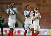 Josh Ononmah of England, Kyle Walker-Peters of England and Lewis Cook of England appluad the England fans at full time during the U21 UEFA EURO first qualifying round match between England and Scotland at the Riverside Stadium, Middlesbrough, England on 6 October 2017. Photo by Paul Thompson.