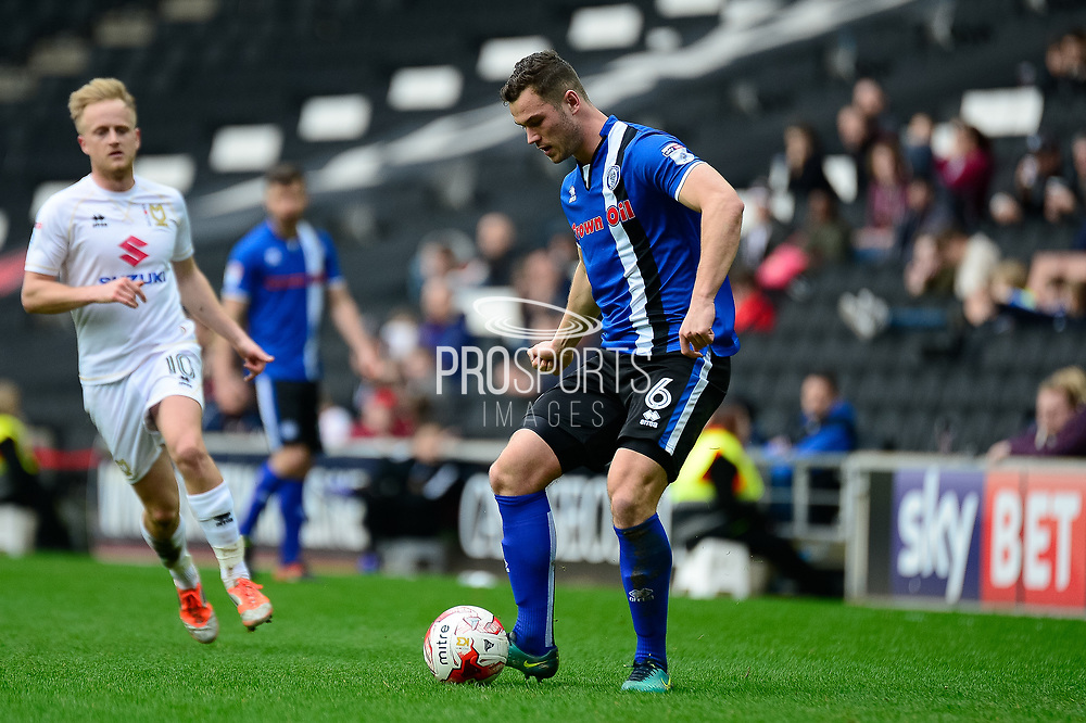 Rochdale defender Harrison McGahey (6) looks to release the ball during the EFL Sky Bet League 1 match between Milton Keynes Dons and Rochdale at stadium:mk, Milton Keynes, England on 11 March 2017. Photo by Dennis Goodwin.