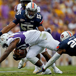October 22, 2011; Baton Rouge, LA, USA; Auburn Tigers defensive end Corey Lemonier (55) and linebacker Daren Bates (25) tackle LSU Tigers running back Michael Ford (42) during the second half at Tiger Stadium. LSU defeated Auburn 45-10. Mandatory Credit: Derick E. Hingle-US PRESSWIRE / © Derick E. Hingle 2011