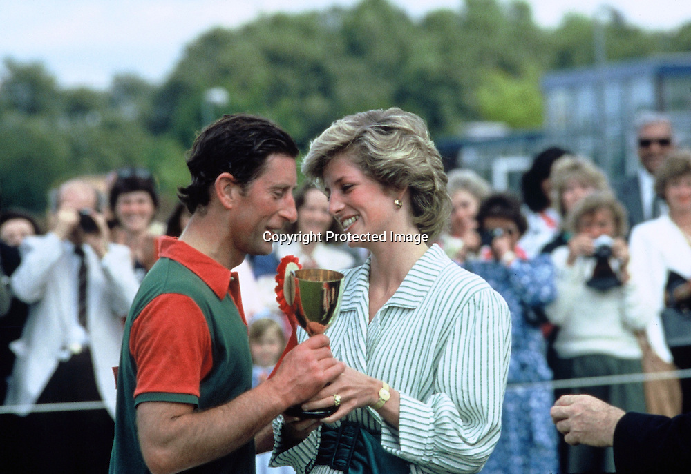 WINDSOR - JUNE 29:  Princess Diana, Princess of Wales kisses Prince Charles, Prince of Wales as she presents him with an award following a charity polo match at Windsor Great Park on June 29, 1985 in Windsor, England. (Photo by Anwar Hussein/Getty Images) *** Local Caption *** Prince Charles, Prince of Wales;Princess Diana, Princess of Wales