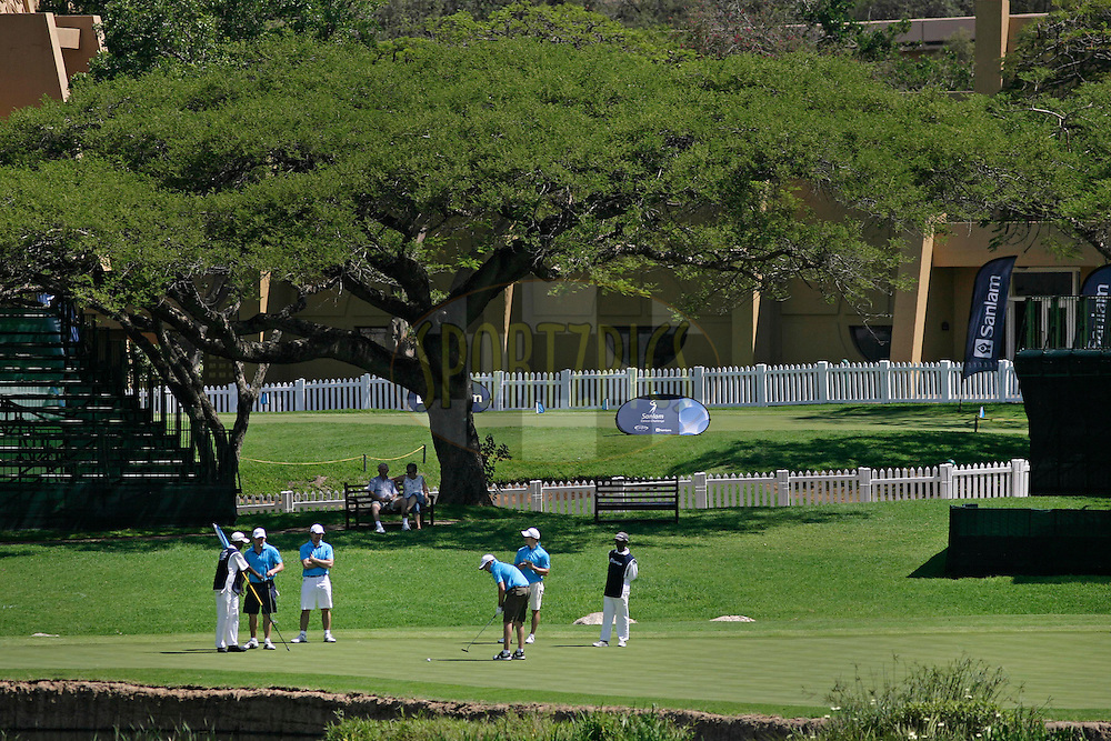 Gielie de Swart, Louis Wilken, Francios Kruger and Dirk Visser putt on the 9th hole during round one of the Sanlam Cancer Challenge Delegates competition 2012 held at The Gary Player Golf and Country Club at Sun City on the 22nd October 2012...Photo by Mark Wessels/SPORTZPICS