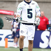 Kyle Dixon #5 of the Chesapeake Bayhawks reacts to a play during the game at Harvard Stadium on April 27, 2014 in Boston, Massachusetts. (Photo by Elan Kawesch)