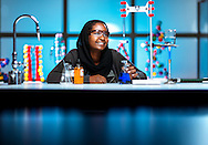 Latifa Aboeid in her STEM Early College at NC A&amp;T chemistry classroom, Tuesday, November 3, 2015, in Greensboro, N.C.<br /> <br /> JERRY WOLFORD and SCOTT MUTHERSBAUGH / Perfecta Visuals<br /> <br /> Some kids say they want to be a firefighter, an astronaut or a teacher when they grow up.<br /> &nbsp;<br /> By fourth grade, Latifa Aboeid knew that she would be a surgeon.<br /> &nbsp;<br /> &ldquo;I go back and forth between neurosurgeon and general surgeon, but I know I&rsquo;ll go to med school,&rdquo; she says.<br /> &nbsp;<br /> The dream isn&rsquo;t very far out from reach. At just 17, Latifa has nearly two years of college credits on her transcript, thanks to the STEM Early College at NC A&amp;T, a new tuition-free Guilford County public high school. She is on track to start medical school by age 19.<br /> &nbsp;<br /> The early college is academically rigorous, and Latifa&rsquo;s a top student. She is researching insulin resistance in Type 1 Diabetes in addition to her regular course load.<br /> &nbsp;