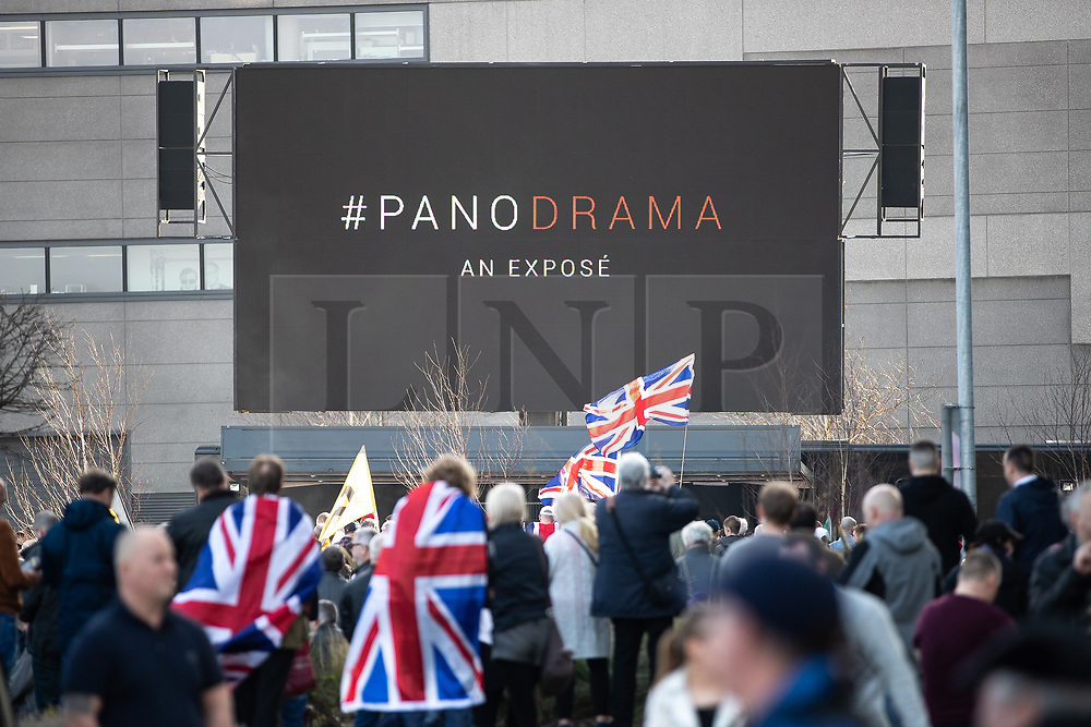 """© Licensed to London News Pictures . 23/02/2019. Salford, UK. TOMMY ROBINSON SUPPORTERS . Supporters of Tommy Robinson (real name Stephen Yaxley-Lennon ) and anti-fascists opposed to the former EDL leader and his followers , gather near to the BBC at Media City to protest , as Yaxley-Lennon hosts a rally showing a home-made documentary , """" Panodrama """" , described as an exposé of the BBC's Panorama documentary series . A BBC Panorama documentary is due to feature an investigation in to Yaxley-Lennon in the near future . Photo credit: Joel Goodman/LNP"""