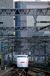 A bullet train approaching Tokyo Station in Japan