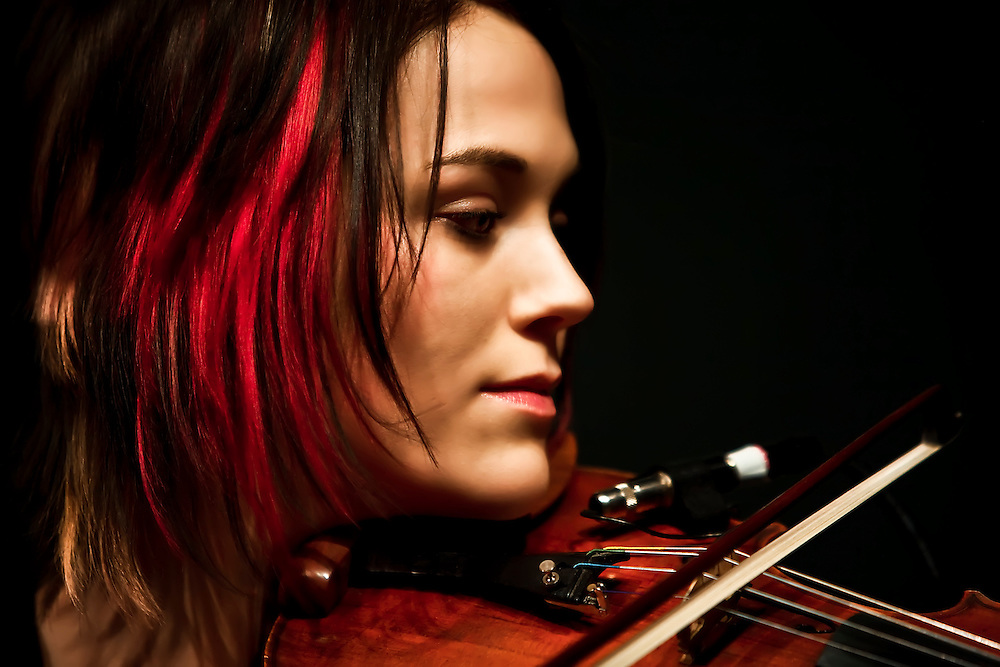 Daily-Daily violinist Kristen Agee performs at studio in Berkeley, CA.  Copyright 2009 Reid McNally.