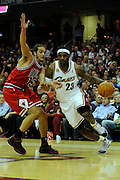 Apr 27, 2010; Cleveland, OH, USA; Cleveland Cavaliers forward LeBron James (23) drives past Chicago Bulls center Joakim Noah (13) during the first period in game five in the first round of the 2010 NBA playoffs at Quicken Loans Arena.  Mandatory Credit: Jason Miller-US PRESSWIRE