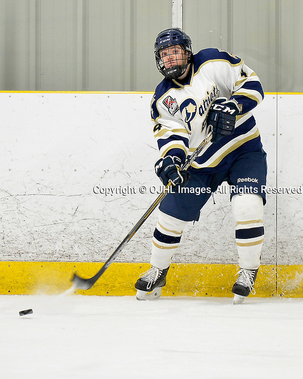 TORONTO, ON - Dec 20, 2014 : Ontario Junior Hockey League game action between Buffalo and Toronto Lakeshore. Tyler Currie #4 of the Toronto Patriots passes the puck during the third period.<br /> (Photo by Shawn Muir / OJHL Images)
