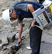 KAOHSIUNG, CHINA - AUGUST 04: (CHINA OUT) <br /> <br /> Gas Explosion Rips up entire road in china<br /> <br /> Rescue workers search for clues after Kaohsiung\'s gas explosion on August 4, 2014 in Kaohsiung, Taiwam of China. Part of the pipeline was found wornout after 4 days of investigations. <br /> ©Exclusivepix