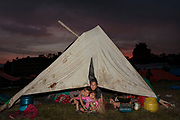 Children from a family left homeless by the 2015 Nepal earthquake inside a tent at a refugee camp for internally displaced people.