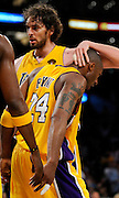 Pau Gasol gives Kobe Bryant a clap on the back of the head in the 3rd quarter. The Lakers defeated the Boston Celtics in game 6 of the NBA Finals 89-67. Los Angeles, CA 06/15/2010 (John McCoy/Staff Photographer).