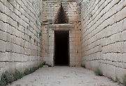 MYCENAE, GREECE - APRIL 13 : A general view of the entrance to the Treasury of Atreus on April 13, 2007 in Mycenae, Peloppenese, Greece. Mycenae, a hill top citadel and palace complex, was the most important place in Greece from c. 1600 to c. 1100 BC. The site was first completely excavated by German archaeologist Heinrich Schliemann between 1874 and 1878. The Treasury of Atreus, c. 13th century BC, is a Tholos tomb, built of huge stone blocks, covered with earth. The entrance passage, or dromos, rises to about 10 metres high where it mets the facade. (Photo by Manuel Cohen/Getty Images)