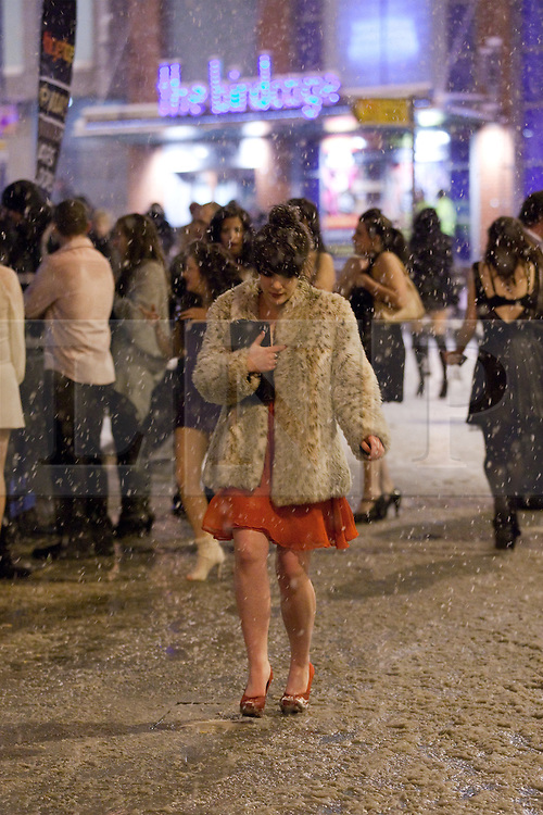 """© under license to London News Pictures. 18/12/2010 as snow blizzards hit Manchester revellers continue their """"Mad Friday"""" night out. The temperature dropped below zero, but that didn't stop many"""