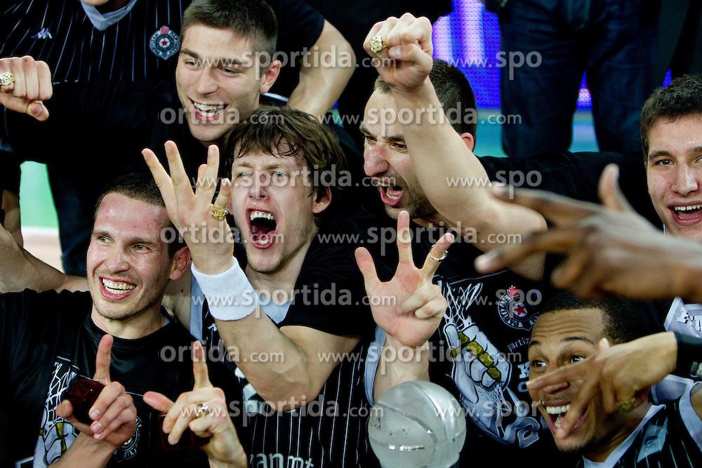Dusan Kecman of Partizan, Jan Vesely Veseli of Partizan, Rasko Katic of Partizan and Curtis Jerrells of Partizan celebrate after the final match of Basketball NLB League at Final four tournament between KK Union Olimpija (SLO) and Partizan Belgrade (SRB), on April 21, 2011 in Arena Stozice, Ljubljana, Slovenia. Partizan defeated Union Olimpija 77-74 and became NLB league Champion 2011.  (Photo By Vid Ponikvar / Sportida.com)