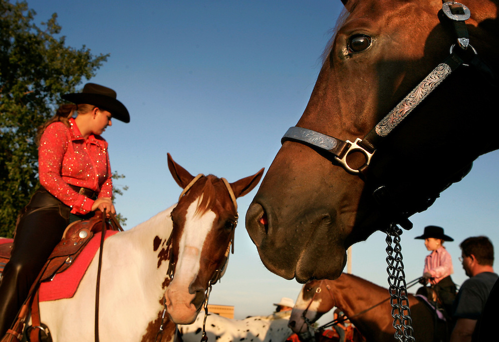 A Legend With Time, a 6-year-old quarter horse, right, looks toward the ring as Greta Cummings of Mount Union, left, looks at Rachel Kuckes, 5, of Mount Pleasant, Sunday, July 30, 2006, before taking part in the horse show at the Des Moines County Fairgrounds in West Burlington. Scott Morgan | The Hawk Eye