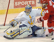 LSSU goaltender Brian Mahoney-Wilson stretches to block a shot by OSU's Sergio Somma during the Lakers win over the Buckeyes Friday night at Taffy Abel Arena in Sault Ste. Marie.
