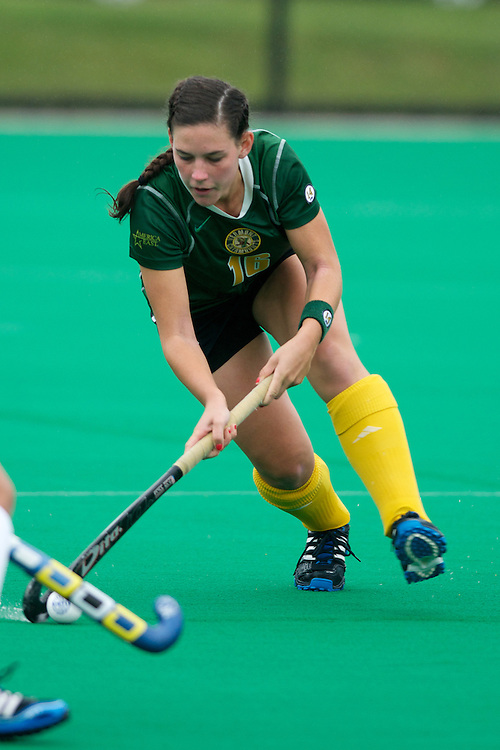 Catamounts midfielder Sally Snickenberger (16) fights for the ball during the women's field hockey game between the Maine Black Bears and the Vermont Catamounts at Moulton/Winder Field on Saturday afternoon September 29, 2012 in Burlington, Vermont.