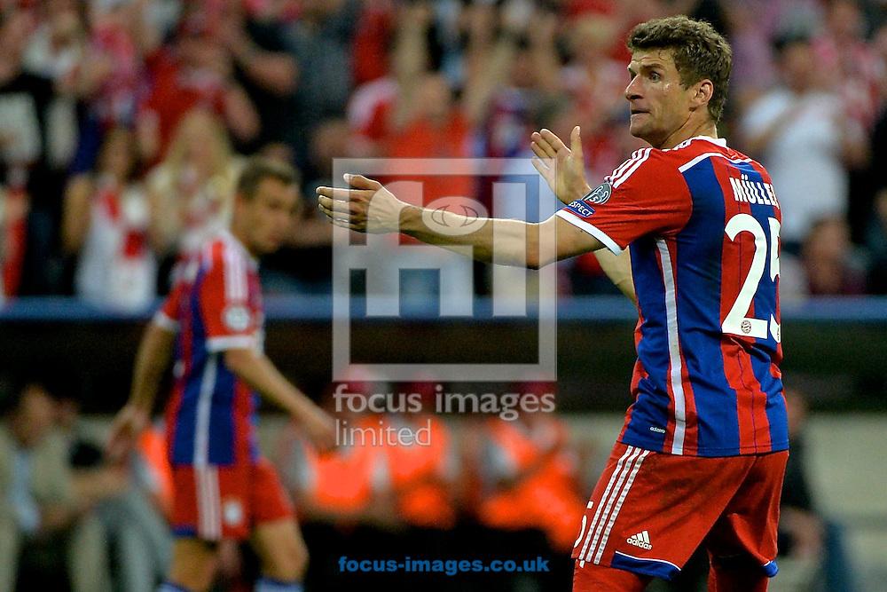 Thomas M&uuml;ller of Bayern Munich celebrates scoring their third goal to make it Bayern Munich 3 FC Barcelona 2 during the UEFA Champions League semi-final match at Allianz Arena, Munich<br /> Picture by Ian Wadkins/Focus Images Ltd +44 7877 568959<br /> 12/05/2015