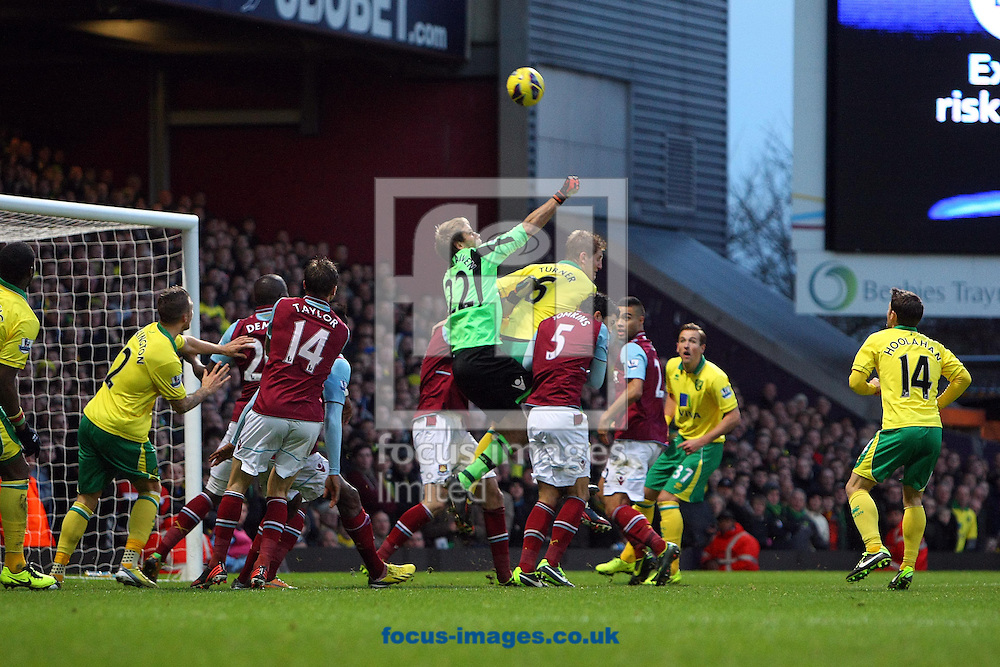 Picture by Paul Chesterton/Focus Images Ltd +44 7904 640267.01/01/2013.Jussi Jaaskelainen of West Ham punches clear during the Barclays Premier League match at the Boleyn Ground, London.