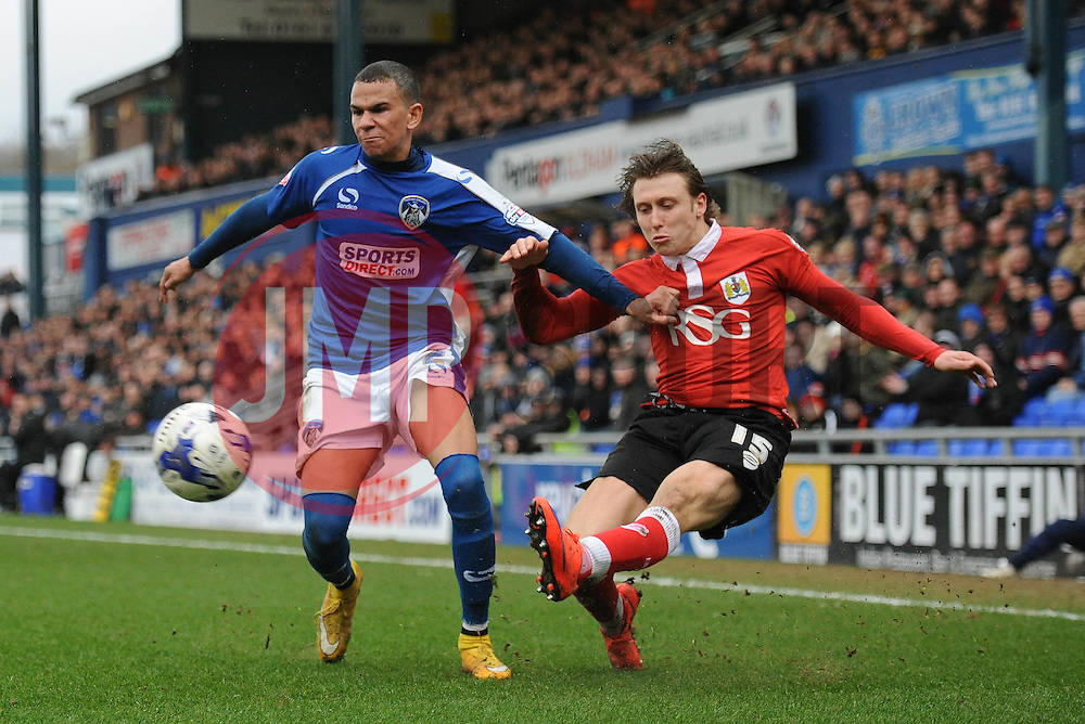 Bristol City's Luke Freeman crosses the ball under pressure from Oldham Athletic's Connor Brown - Photo mandatory by-line: Dougie Allward/JMP - Mobile: 07966 386802 - 03/04/2015 - SPORT - Football - Oldham - Boundary Park - Bristol City v Oldham Athletic - Sky Bet League One