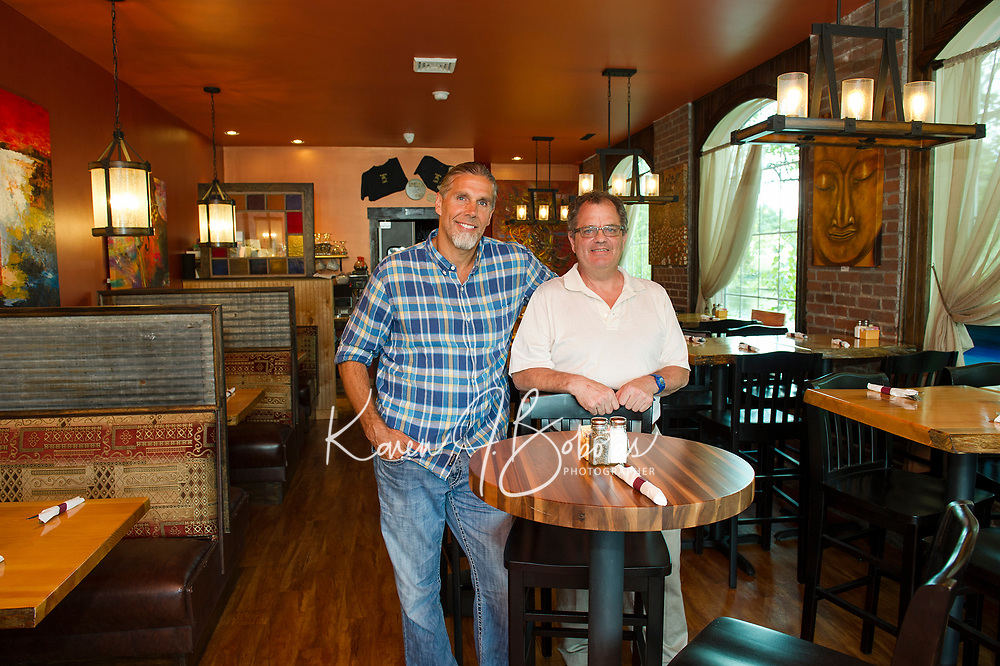 Randy Bartlett and Everett Henderson in the Karma Cafe on Tuesday afternoon.  (Karen Bobotas/for the Laconia Daily Sun)