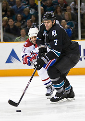 March 4, 2010; San Jose, CA, USA; San Jose Sharks defenseman Niclas Wallin (7) keeps the puck from Montreal Canadiens center Scott Gomez (91) during the first period at HP Pavilion.  San Jose defeated Montreal 3-2. Mandatory Credit: Jason O. Watson / US PRESSWIRE