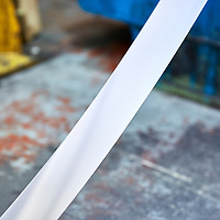 A photograph of a pristine, clean piece of stainless steel fresh off the production line in a british stainless steel factory