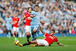 Sergio Aguero of Manchester City is tackled by Marcos Rojo of Manchester United - Photo mandatory by-line: Rogan Thomson/JMP - 07966 386802 - 02/11/2014 - SPORT - FOOTBALL - Manchester, England - Etihad Stadium - Manchester City v Manchester United - Barclays Premier League.