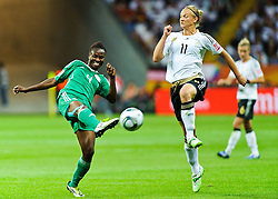 30.06.2011, Commerzbank-Arena, Frankfurt, GER, FIFA Women Worldcup 2011, GRUPPE A, Deutschland (GER) vs. Nigeria (NGR) , im Bild Perpetua NKWOCHA (NGA #4,Sunnana SWE)  im Zweikampf mit Alexnadra Popp (Deutschland #11, Duisburg) // during the FIFA Women Worldcup 2011, Pool A, Germany vs. Nigeria on 2011/06/30, Commerzbank-Arena, Frankfurt, Germany. EXPA Pictures © 2011, PhotoCredit: EXPA/ nph/  Roth       ****** out of GER / CRO  / BEL ******