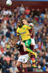 John Terry of Aston Villa climbs with Cameron Jerome of Norwich City and Glenn Whelan - Mandatory by-line: Paul Roberts/JMP - 19/08/2017 - FOOTBALL - Villa Park - Birmingham, England - Aston Villa v Norwich City - Sky Bet Championship