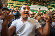 "01 FEBRUARY 2014 - BANGKOK, THAILAND: Thai voters try to get into the district office in Din Daeng in Bangkok so they could vote. They were not able to vote because protestors blocked the polls. Thais went to the polls in a ""snap election"" Sunday called in December after Prime Minister Yingluck Shinawatra dissolved the parliament in the face of large anti-government protests in Bangkok. The anti-government opposition, led by the People's Democratic Reform Committee (PDRC), called for a boycott of the election and threatened to disrupt voting. Many polling places in Bangkok were closed by protestors who blocked access to the polls or distribution of ballots. The result of the election are likely to be contested in the Thai Constitutional Court and may be invalidated because there won't be quorum in the Thai parliament.    PHOTO BY JACK KURTZ"