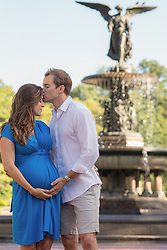 man with pregnant woman in Central Park, New York City