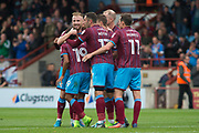 Scunthorpe celebrate as Scunthorpe United midfielder Duane Holmes (19) scores a goal 2-0 during the EFL Sky Bet League 1 match between Scunthorpe United and Portsmouth at Glanford Park, Scunthorpe, England on 23 September 2017. Photo by Craig Zadoroznyj.