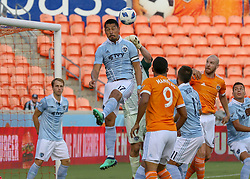 July 18, 2018 - Houston, TX, U.S. - HOUSTON, TX - JULY 18:  Sporting Kansas City midfielder Roger Espinoza (17) heads the ball out of the goal area during the US Open Cup Quarterfinal soccer match between Sporting KC and Houston Dynamo on July 18, 2018 at BBVA Compass Stadium in Houston, Texas. (Photo by Leslie Plaza Johnson/Icon Sportswire) (Credit Image: © Leslie Plaza Johnson/Icon SMI via ZUMA Press)